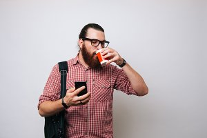 Young bearded man enjoying coffee