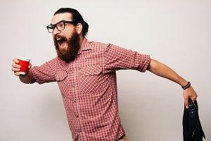 bearded man running wearing glasses