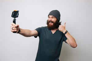 bearded man showing thumbs up