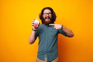 man pointing at ice cream