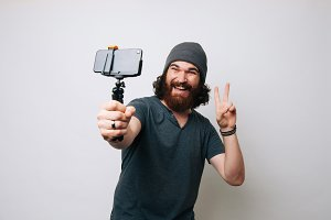 hipster man taking a selfie
