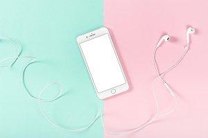 Mobile phone headphones flat lay