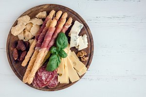Wooden board with appetizers