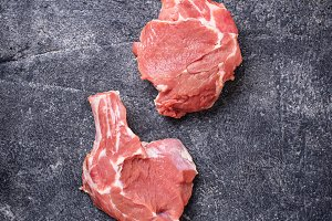 Raw meat on dark background