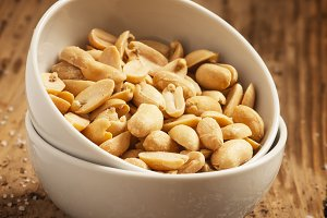 Roasted peanuts and salt in a bowl o