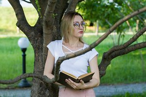 Attractive young woman with a book