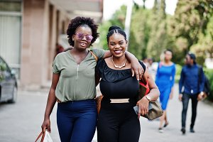 Two african american girls walking a