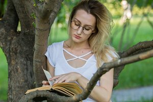 Caucasian young woman reading a book