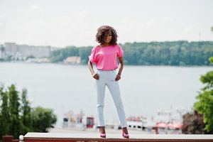 African american curly girl posed at