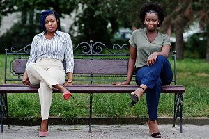 Two african girls posed at street of