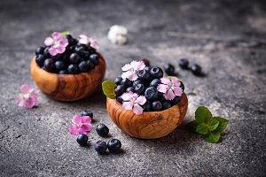 Fresh ripe blueberries in wooden