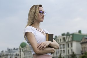 Young melancholic woman with a book