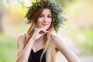 Young beautiful woman in a wreath