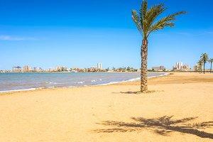 European sandy beach, boat and blue