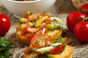 Italian bruschetta with tomato, onio