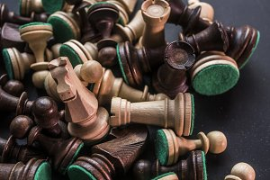 close up messy chess pieces on the d