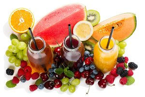 Berry and fruit juices in bottles, a
