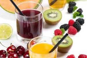 Berry and fruit juices in glasses.