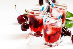 Cherry red drink with ice in a heart