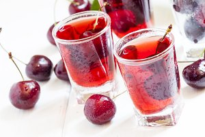 Fresh cherry juice with berries, sel