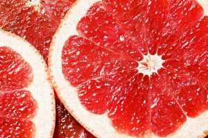Slices of red grapefruit, top view,