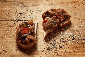bread and Caponata Eggplant on a woo