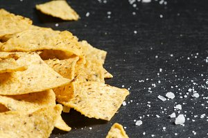 Nachos and salt on a dark background
