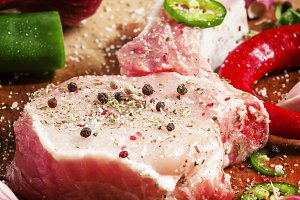 Raw meat pork steak with spices, sel