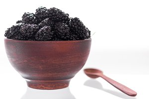 Full blackberry dish. Clay plate and