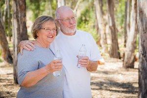 Happy Healthy Senior Couple with Wat