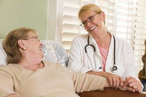 Doctor or Nurse Talking to Sitting S