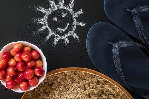 summer holidays flat lay on chalkboa