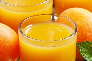 Fresh apricot juice and apricots wit