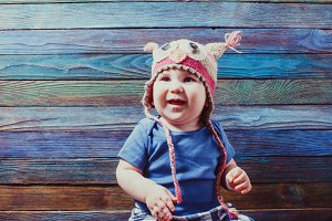 Cute baby in animal funny hat