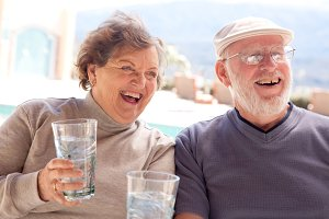 Happy Senior Adult Couple with Drink