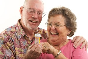 Senior Couple with Prescription Bott