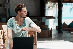 Man freelancer working in laptop