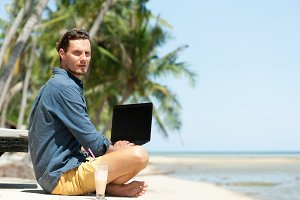 Man freelancer at the beach