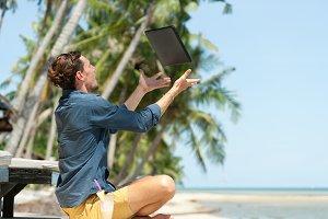 Man freelancer at the beach