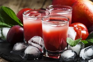 Red fruit cocktail with ice, selecti