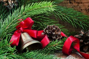 Christmas bell with a red ribbon, pi