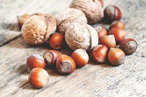 Hazelnuts and walnuts on an old wood