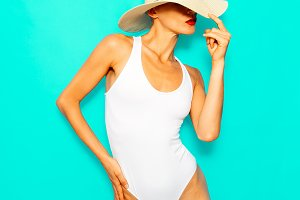 Model in a fashion white swimsuit an
