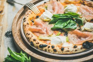 Freshly baked Italian pizza with ham