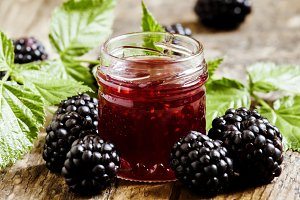 Jar of blackberry jam, fresh berries