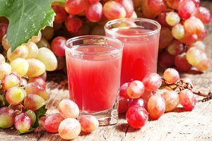 Grape juice pink grapes with fresh b