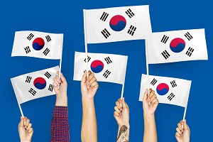 Hands waving flags of South Korea