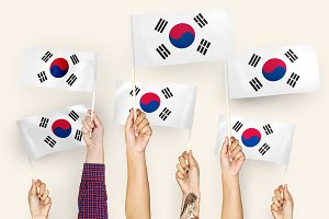 Hands waving flags of South Korea