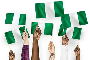 Hands waving the flags of Nigeria