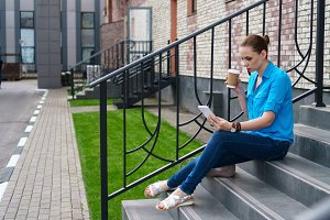 Girl with tablet pc and coffee